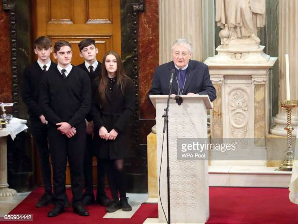 Rev Harold Good speaks while Martin McGuinness' grandchildren look on behind him during his funeral service at St Columba's Church Long Tower on...