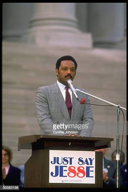 Rev Jesse Jackson addressing campaign rally on Capitol steps during his quest for Dem pres nomination speaking at just say Jesse sign adorned podium