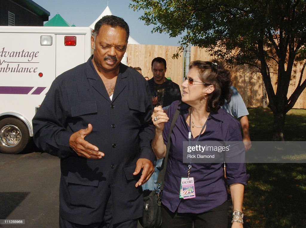 Rev. Jessie Jackson and Carolyn Mulgar during FARM AID 2005 Presented by SILK Soymilk at Tweeter Center in Tinley Park, Illinois, United States.