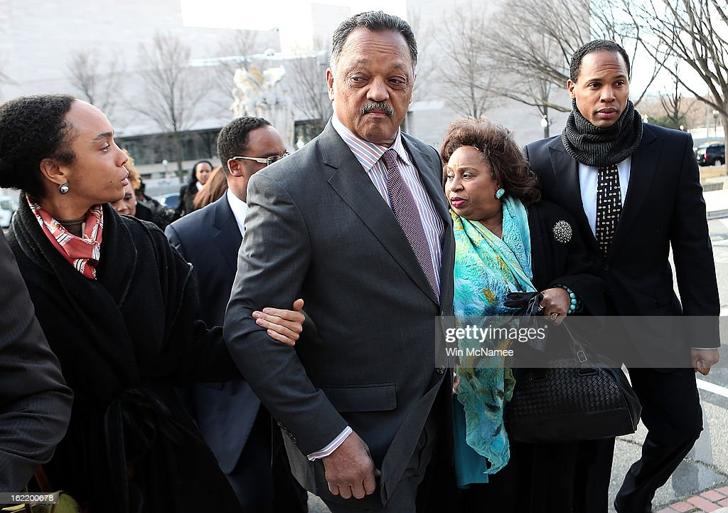 Rev. Jesse Jackson (2nd L) and his wife Jacqueline Lavinia Brown (2nd R) arrive at U.S. District Court for a hearing involving his son, former Rep. Jesse Jackson Jr., February 20, 2013 in Washington, DC. Jackson Jr. and his wife, Sandi Jackson, are expected to plead guilty to federal charges after being accused of spending more than $750,000 in campaign funds to purchase luxury items, memorabilia and other goods.