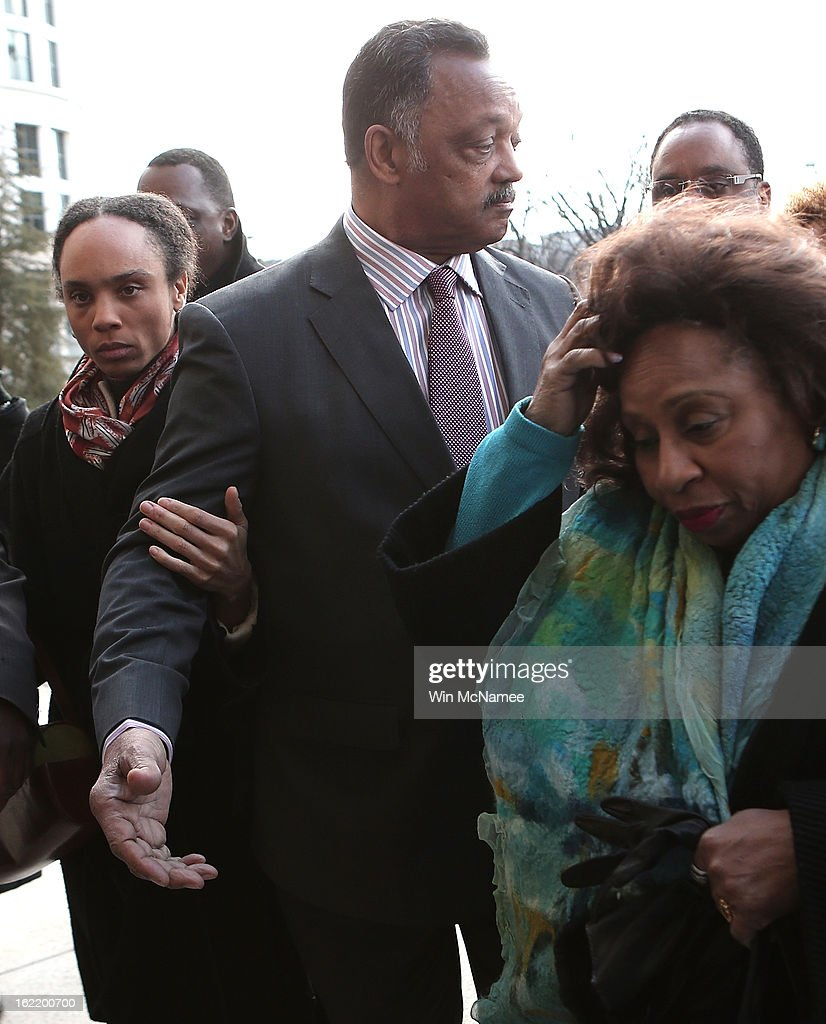 Rev. Jesse Jackson (C) and his wife Jacqueline Lavinia Brown (R) arrive at U.S. District Court for a hearing involving his son, former Rep. Jesse Jackson Jr., February 20, 2013 in Washington, DC. Jackson Jr. and his wife, Sandi Jackson, are expected to plead guilty to federal charges after being accused of spending more than $750,000 in campaign funds to purchase luxury items, memorabilia and other goods.