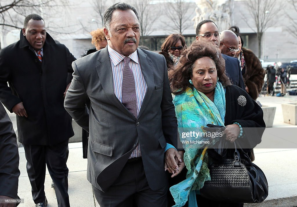 Rev. Jesse Jackson (L) and his wife Jacqueline Lavinia Brown (R) arrive at U.S. District Court for a hearing involving his son, former Rep. Jesse Jackson Jr., February 20, 2013 in Washington, DC. Jackson Jr. and his wife, Sandi Jackson, are expected to plead guilty to federal charges after being accused of spending more than $750,000 in campaign funds to purchase luxury items, memorabilia and other goods.
