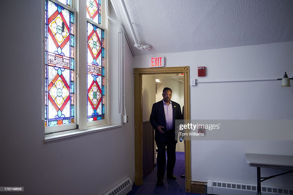 Rev. Jesse Jackson arrives to the Metropolitan African Methodist Episcopal Church on M Street, NW, for a pre-rally before a march to the White House to protest what is seen as President Obama's lack of action in addressing a variety of problems in black communities.