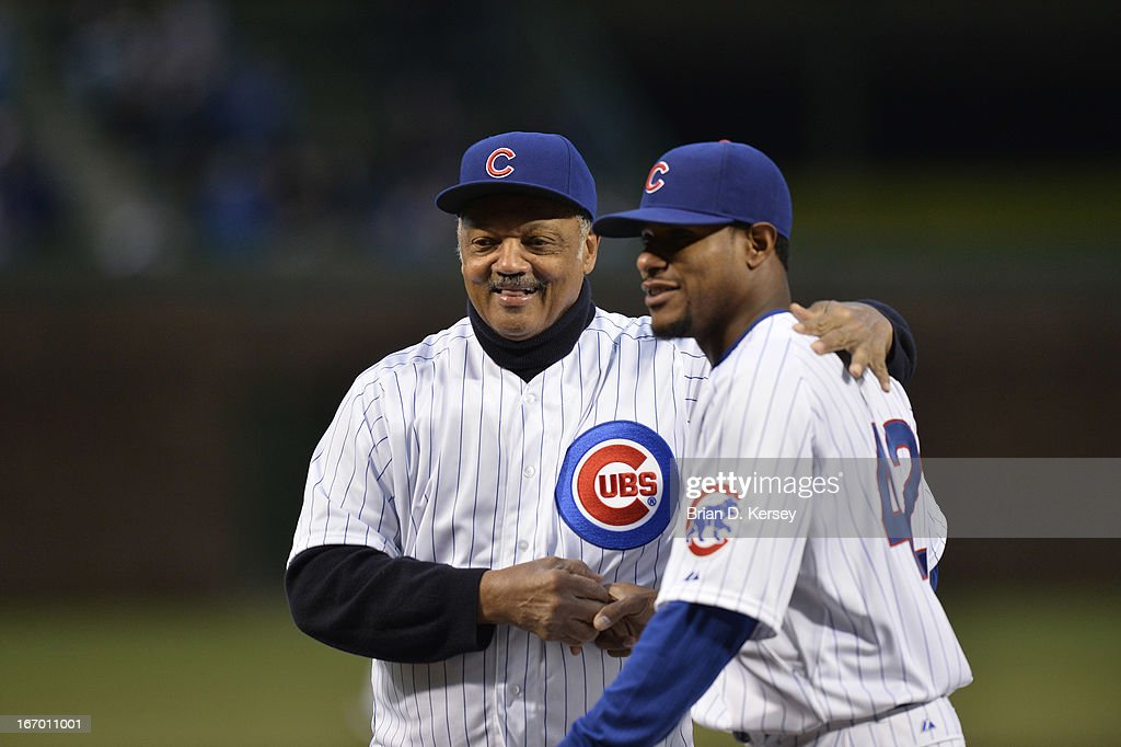 Rev. Jesse Jackson Sr. (L) shakes hands with Edwin Jackson of the Chicago Cubs after throwing out a ceremonial first pitch before the game against the Texas Rangers at Wrigley Field on April 16, 2013 in Chicago, Illinois. All uniformed team members wore jersey number 42 in honor of Jackie Robinson Day. The Rangers defeated the Cubs 4-2.