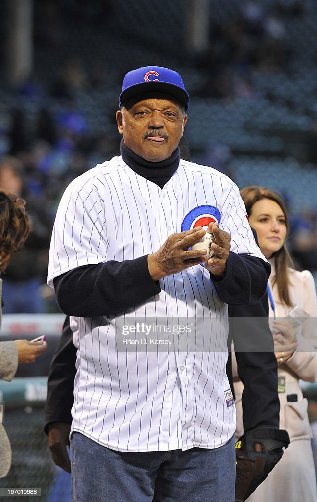 Rev. Jesse Jackson Sr. stands on the field before the Chicago Cubs game against the Texas Rangers at Wrigley Field on April 16, 2013 in Chicago, Illinois. Jackson threw out a ceremonial first pitch as all uniformed team members wore jersey number 42 in honor of Jackie Robinson Day. The Rangers defeated the Cubs 4-2.