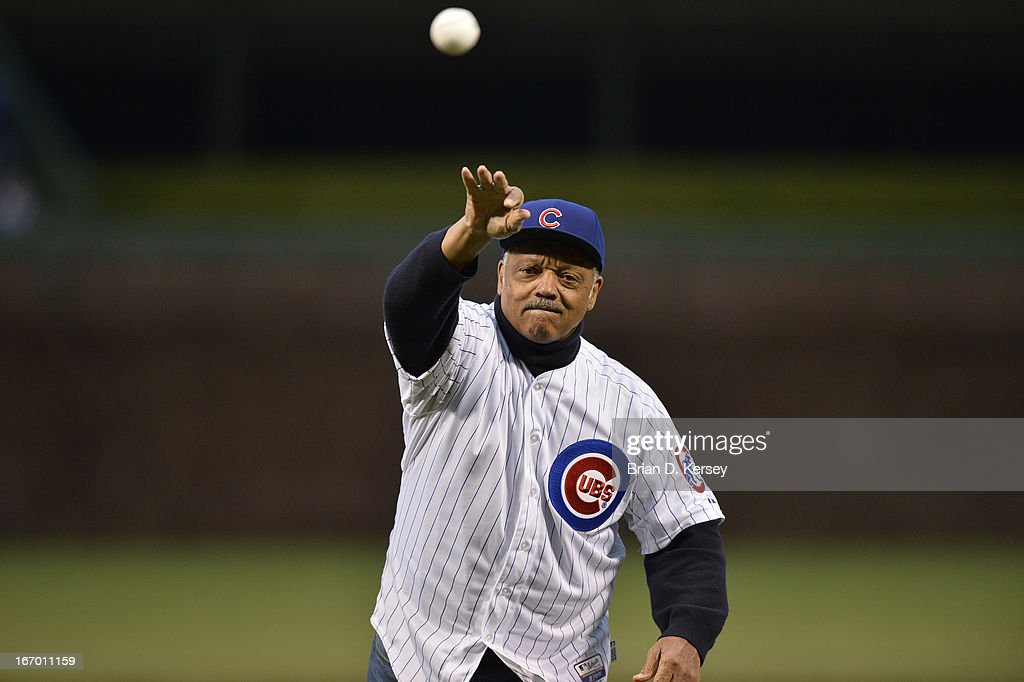 Rev. Jesse Jackson Sr. throws out a ceremonial first pitch before the Chicago Cubs Texas Rangers gameat Wrigley Field on April 16, 2013 in Chicago, Illinois. All uniformed team members are wore jersey number 42 in honor of Jackie Robinson Day. The Rangers defeated the Cubs 4-2.