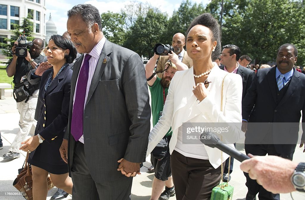 Rev. Jesse Jackson Sr. walks away after speaking to the media following a sentencing hearing for his son, former Illinois Congressman Jesse Jackson Jr., and his wife, Sandi Jackson, at the US District Court in Washington, DC, August 14, 2013. Jackson was sentenced today to 30 months behind bars and his wife, Sandi, got a year in prison for separate felonies involving the misspending of about $750,000 in campaign funds. The Jacksons will be allowed to serve their sentences one at a time, with Jackson Jr. going first. In addition to the 2.5 years in prison, Jackson Jr. was sentenced to three years of supervised release. Sandi Jackson was ordered to serve 12 months of supervised release following her prison term. AFP PHOTO / Saul LOEB