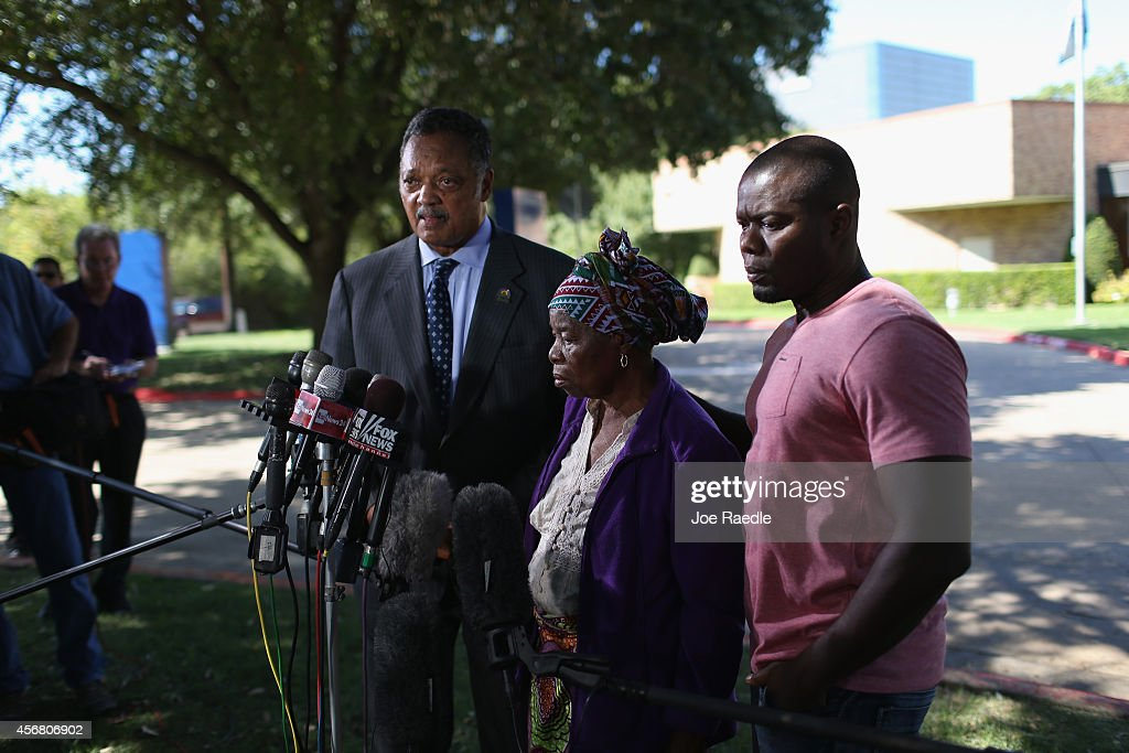 Rev. Jesse Jackson (L) stands with Nowai korkoyah (C) the mother of Ebola patient Thomas Eric Duncan, as well as his nephew, Josephus Weeks, as they speak to the media at the Texas Health Presbyterian hospital on October 7, 2014 in Dallas, Texas. Rev. Jesse Jackson was visiting Dallas to show support of Ebola patient Thomas Eric Duncan and his family.