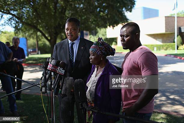Rev Jesse Jackson stands with Nowai korkoyah the mother of Ebola patient Thomas Eric Duncan as well as his nephew Josephus Weeks as they speak to the...