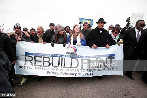 Rev Jesse Jackson walks in a national milelong march to highlight the push for clean water in Flint February 19 2016 in Flint Michigan Rev Jackson...