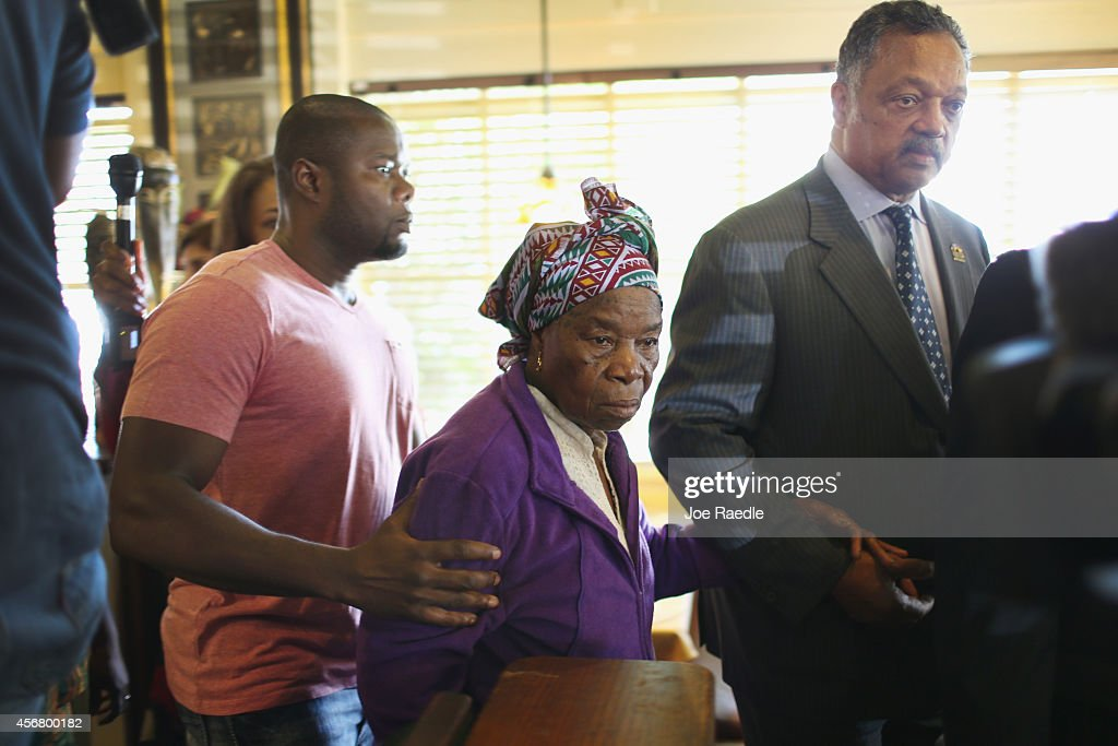 Rev. Jesse Jackson (R) walks with Nowai korkoyah (C), the mother of Ebola patient Thomas Eric Duncan, as well as his nephew, Josephus Weeks (L), after they spoke to the media at the South Dallas Cafe on October 7, 2014 in Dallas, Texas. Rev. Jesse Jackson was visiting Dallas to show support of Ebola patient Thomas Eric Duncan and his family.