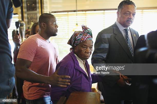 Rev Jesse Jackson walks with Nowai korkoyah the mother of Ebola patient Thomas Eric Duncan as well as his nephew Josephus Weeks after they spoke to...