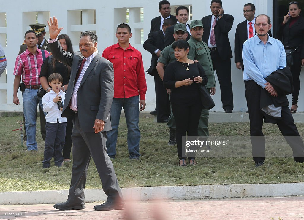 Rev. Jesse Jackson (L) waves to the crowd while departing the funeral for Venezuelan President Hugo Chavez at the Military Academy on March 8, 2013 in Caracas, Venezuela. Countless Venezuelans have paid their last respects to Chavez and more than 30 heads of state were expected to attend the funeral today.