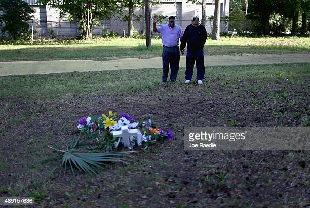 Rev Larry Bratton and Geno Jones pray at a memorial setup on the site where Walter Scott was killed on April 4th by a North Charleston police officer...