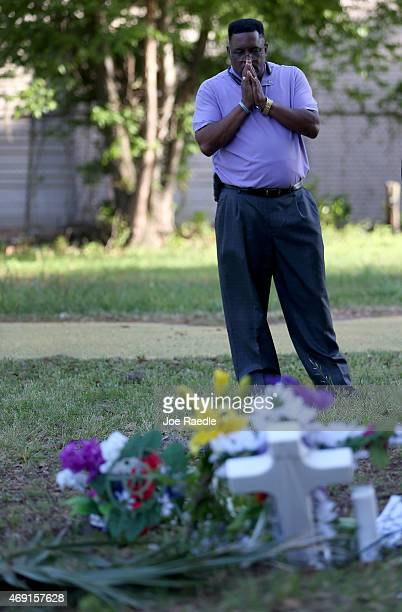 Rev Larry Bratton prays at a memorial setup on the site where Walter Scott was killed on April 4th by a North Charleston police officer on April 10...