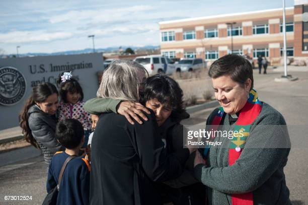 Rev Nancy Niero hugs Jeanette Vizguerra next to Rev Anne Dunlap after Vizguerra returned from meeting with immigration authorities Vizguerra's stay...