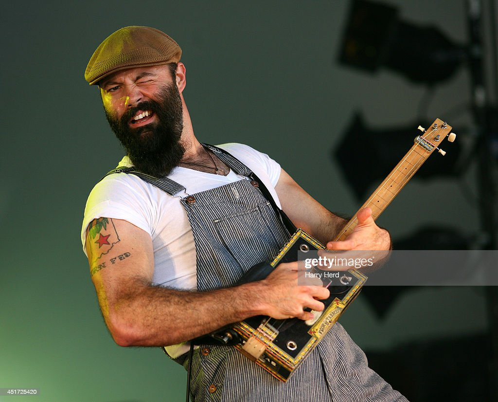 Rev. Peyton of Reverend Peyton's Big Damn Band performs on stage at Cornbury Music Festival at Great Tew Estate on July 5, 2014 in Oxford, United Kingdom.