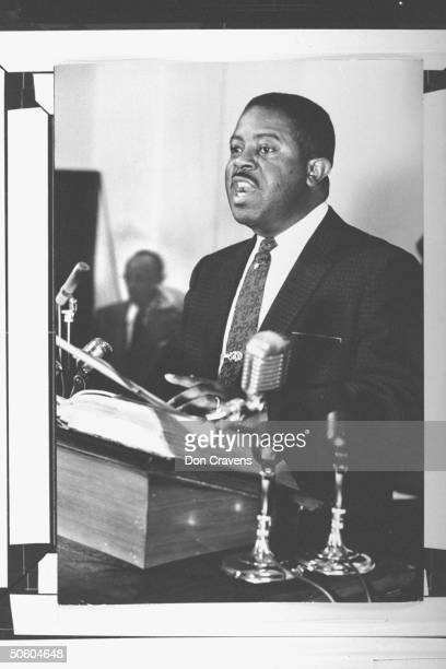Rev Ralph Abernathy coorganizer of segregated bus boycott speaking passionately fr church pulpit as he expresses his outrage over the policy of...