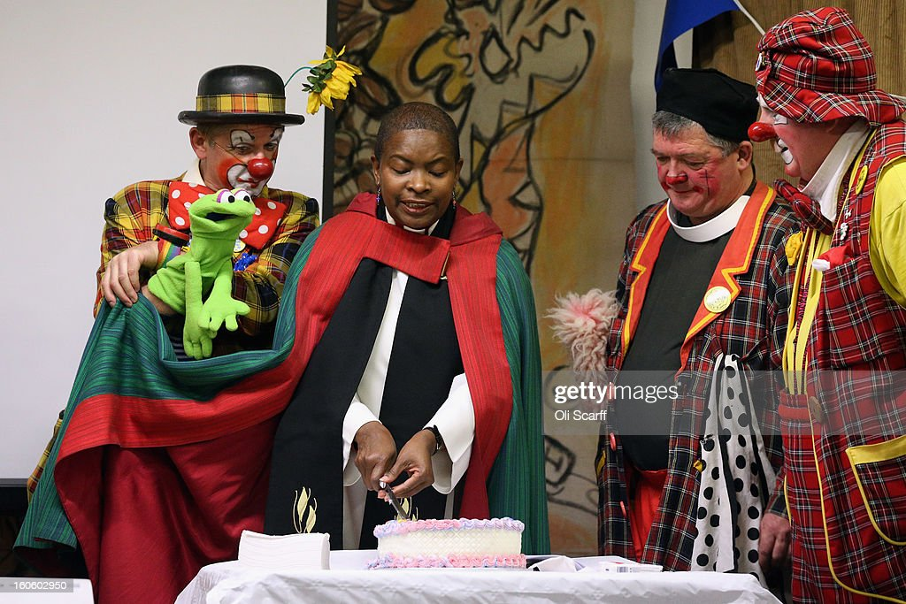 Rev Rose Hudson-Wilkin (2nd-L) cuts a cake on stage with clowns in full costume after the annual Clowns Church Service at Holy Trinity Church in Dalston on February 3, 2013 in London, England. Clowns attend the service in memory of Joseph Grimaldi (1778-1837), the most celebrated English clown who was born in London. The service has been an annual tradition since 1946 with the attending clowns usually performing for the public afterwards.