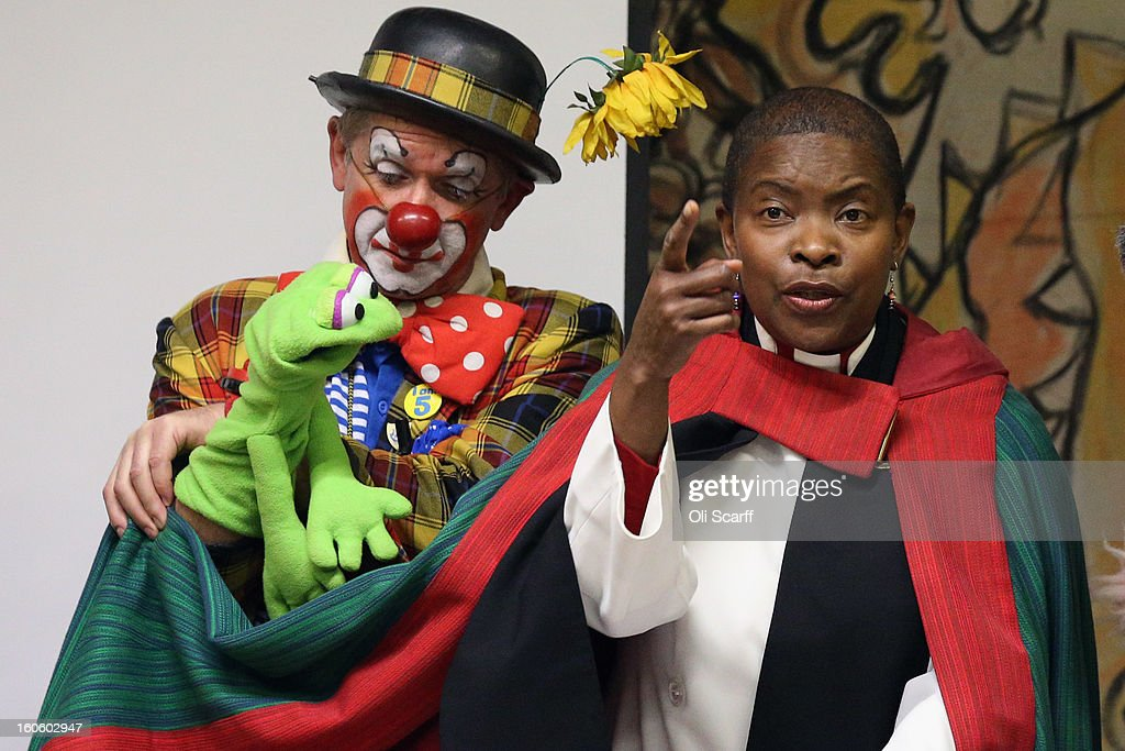 Rev Rose Hudson-Wilkin (R) on stage with clowns in full costume after the annual Clowns Church Service at Holy Trinity Church in Dalston on February 3, 2013 in London, England. Clowns attend the service in memory of Joseph Grimaldi (1778-1837), the most celebrated English clown who was born in London. The service has been an annual tradition since 1946 with the attending clowns usually performing for the public afterwards.