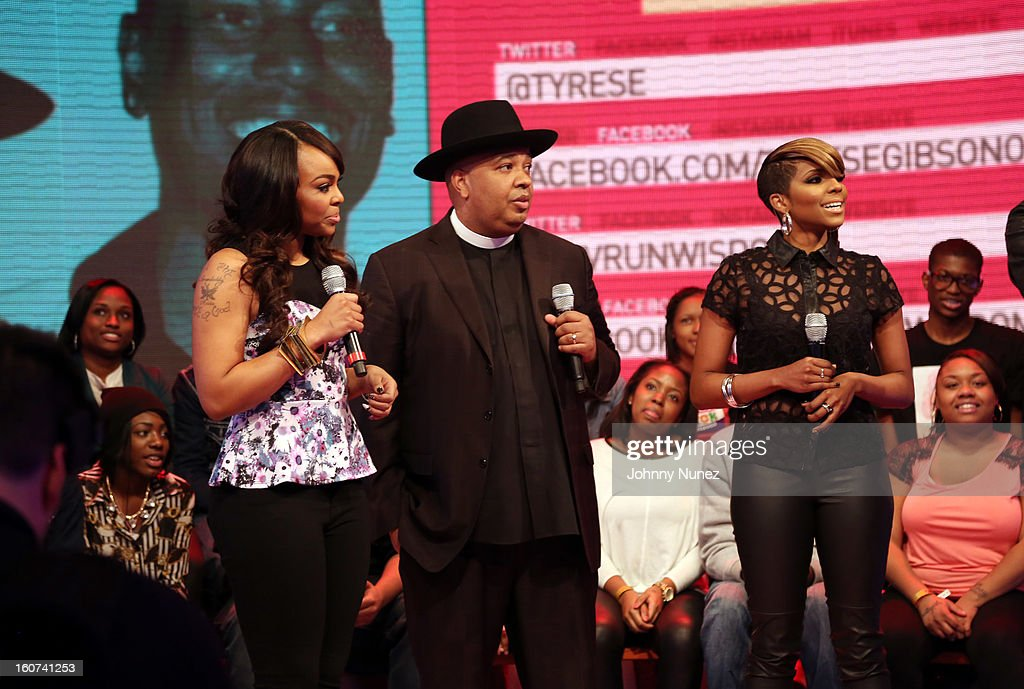 Rev Run (c) visits BET's '106 & Park' with hosts Kimberly 'Paigion' Walker (L) and Ms. Mykie (r) at 106 & Park Studio on February 4, 2013 in New York City.