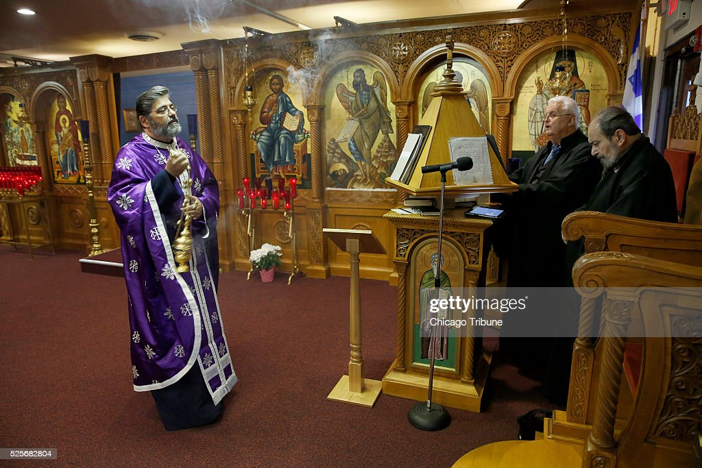 Rev. Sotirios Dimitriou uses incense near the icon of St. John the Baptist at Assumption Greek Orthodox Church in Homer Glen, Ill., on Thursday, April 28, 2016. Dimitriou, recently had been hospitalized. When he went to kiss the icon he saw and smelled what they described as a fragrant oil seeping from John the Baptist's hands, hair, halo and beard -- everywhere but his eyes. Since that day, the priest's health gradually has improved. 'I can't explain to you the reason why it started,' Dimitriou said. 'It's a blessing for our community.'