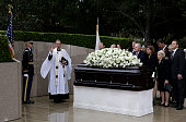 Rev Stuart A Kenworthy vicar of Washington National Cathedral left says a blessing at Nancy Reagan's casket at her gravesite at the Ronald Reagan...
