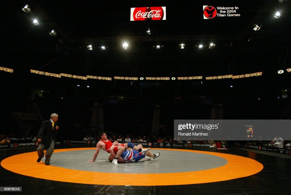 Revaz Chelidze of the Republic of Georgia top battles with Rulon Gardner in GrecoRoman Wrestling during the Titan Games at Philips Arena on June 19...