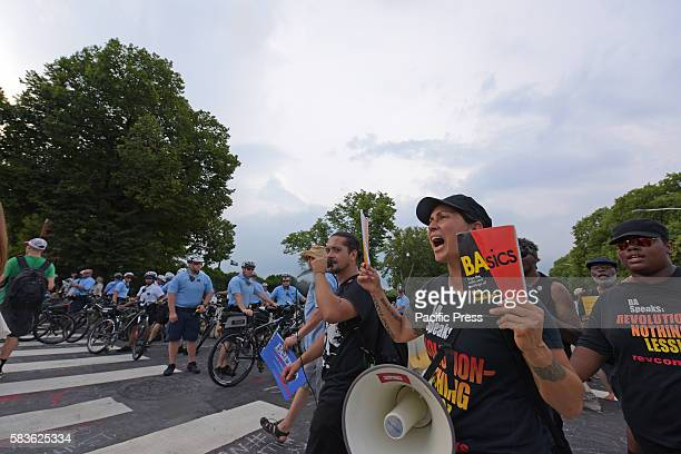 RevCom members march chant Thousands of activists filled downtown Philadelphia FDR Park to protest on behalf of environmental issues economic...