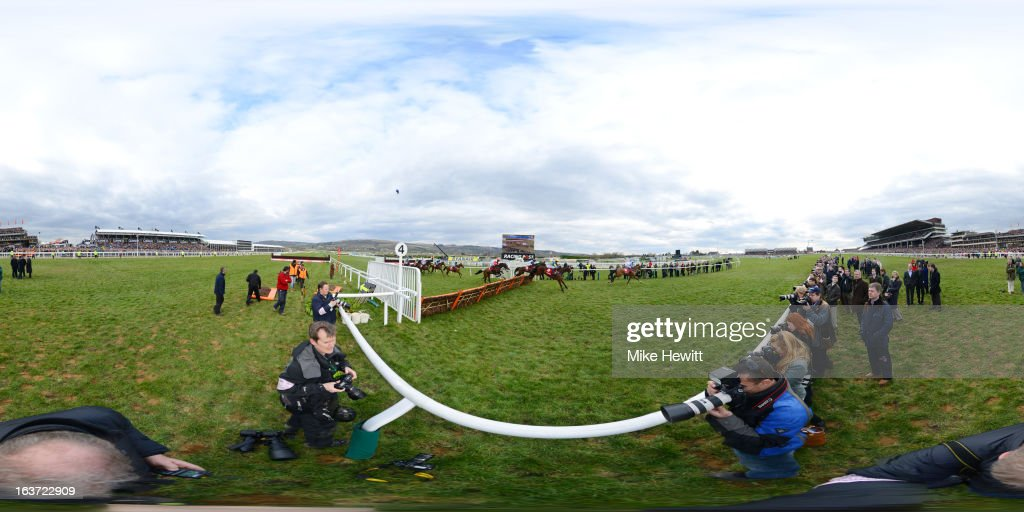 Reve de Sivola leads the field in the Ladbrokes World Chase during St Patrick's Thursday at Cheltenham racecourse on March 14 2013 in Cheltenham...