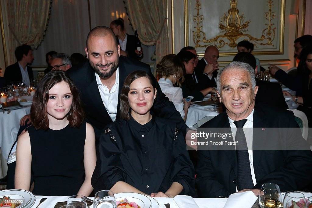 Revelation for 'Bang Gang...', Marilyn Lima, her sponsor Marion Cotillard, Jerome Commandeur and President of Academy des Cesars Alain Terzian attend the 'Cesar - Revelations 2017' Dinner at Hotel Meurice on January 16, 2017 in Paris, France.