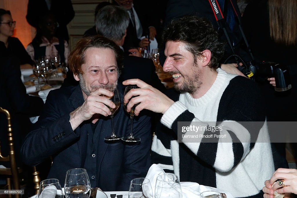 Revelation for 'Rester vertical', Damien Bonnard (R) and his sponsor Mathieu Amalric (L) attend the 'Cesar - Revelations 2017' Dinner at Hotel Meurice on January 16, 2017 in Paris, France.
