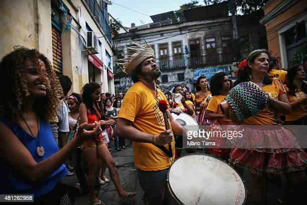 A reveler dances during a 'Festas Juninas' marching performance by the street band 'Monobloco' on July 18 2015 in Rio de Janeiro Brazil 'Festas...