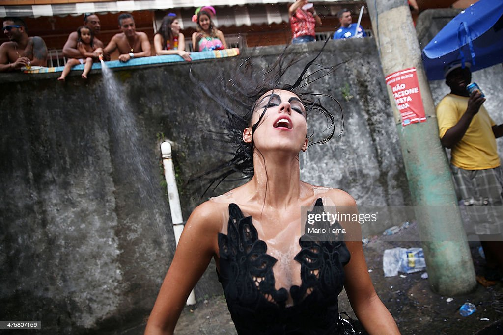 A reveler dances during the 'Ceu na Terra' street carnival bloco on March 1, 2014 in Rio de Janeiro, Brazil. Carnival is the grandest holiday in Brazil, annually drawing millions in raucous celebrations.