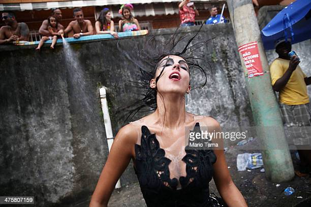 A reveler dances during the 'Ceu na Terra' street carnival bloco on March 1 2014 in Rio de Janeiro Brazil Carnival is the grandest holiday in Brazil...