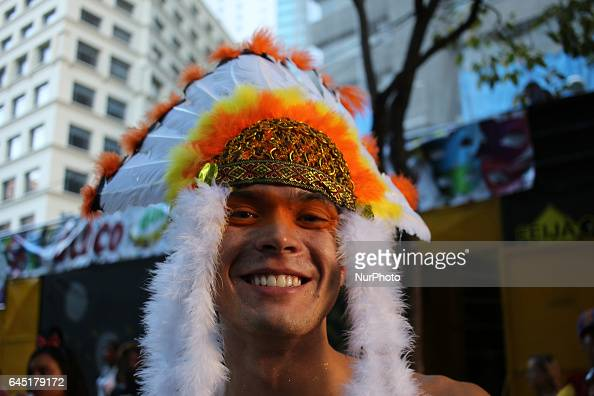 Reveler dressed as Indians have fun in the streets of Rio during Carnival Street carnival in Rio de Janeiro Throughout the city hundreds of carnival...