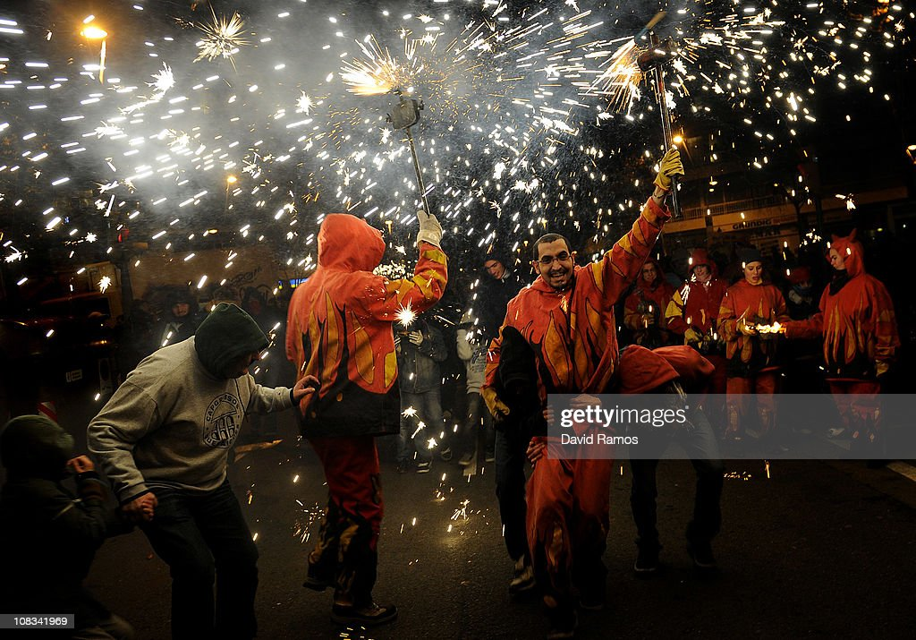 Reveler dressed up as a devil run holding a torch with firecrackers while taking part in a 'Correfoc' or 'Fire-runs' during the Sant Antoni neighborhood celebrations on January 23, 2011 in Barcelona, Spain. 'Correfoc' is a traditional Catalan festival dated from the 12th century where people dress up as a devil to run dancing among firecrackers.