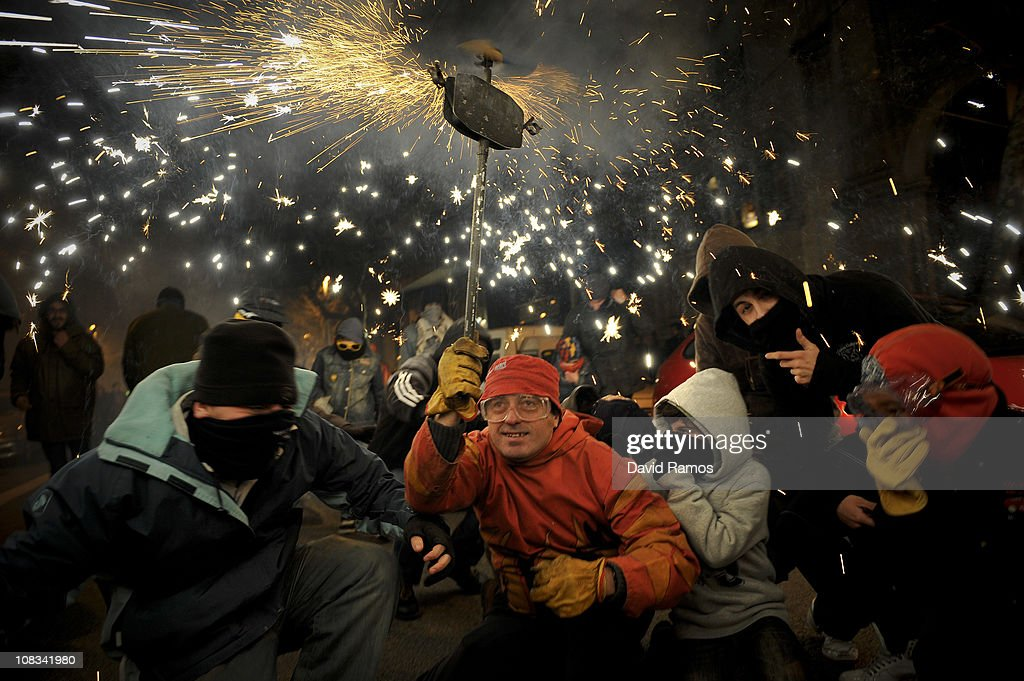 A reveler dressed up as a devil runs holding a torch with firecrackers while taking part in a 'Correfoc' or 'Fire-runs' during the Sant Antoni neighborhood celebrations on January 23, 2011 in Barcelona, Spain. 'Correfoc' is a traditional Catalan festival dated from the 12th century where people dress up as a devil to run dancing among firecrackers.