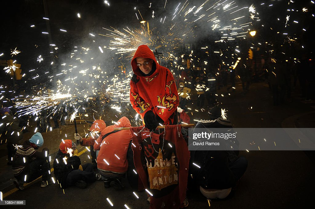 A reveler dressed up as a devil takes part in a 'Correfoc' or 'Fire-runs' during the Sant Antoni neighborhood celebrations on January 23, 2011 in Barcelona, Spain. 'Correfoc' is a traditional Catalan festival dated from the 12th century where people dress up as a devil to run dancing among firecrackers.