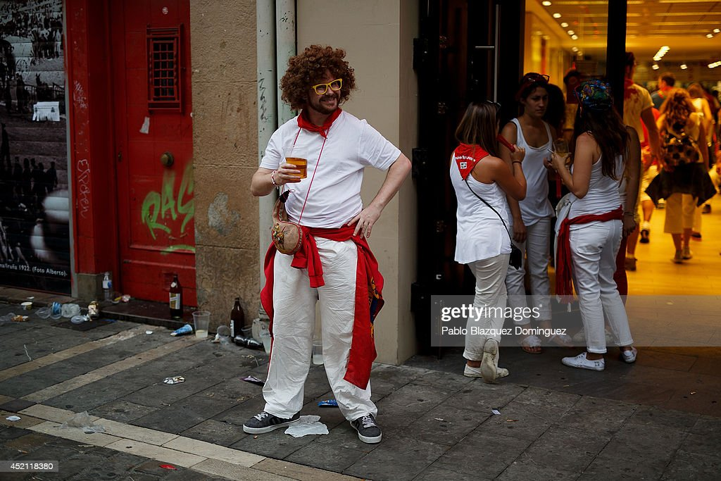 A reveler enjoys a drink in the street during the eighth day of the San Fermin Running Of The Bulls festival on July 13, 2014 in Pamplona, Spain. The annual Fiesta de San Fermin, made famous by the 1926 novel of US writer Ernest Hemingway 'The Sun Also Rises', involves the running of the bulls through the historic heart of Pamplona.