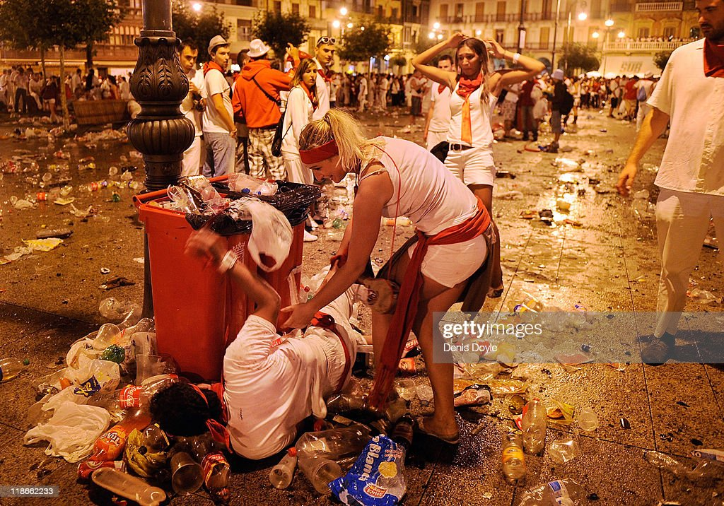 A reveler is helped onto his feet after falling in the early morning before the fourth day of the San Fermin running-of-the-bulls on July 10, 2011 in Pamplona, Spain. Pamplona's famous Fiesta de San Fermin, which involves the running of the bulls through the historic heart of Pamplona for eight days starting July 7th, was made famous by the 1926 novel 'The Sun Also Rises' by Ernest Hemingway.