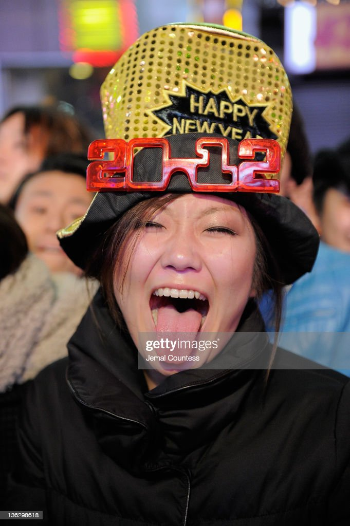 A reveler makes a face as she joins thousands gathered in New York's Times Square to celebrate the ball drop at the annual New Years Eve celebration on December 31, 2011 in New York City.