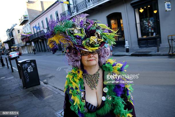 A reveler makes her way through the French Quarter during Mardi Gras day on February 9 2016 in New Orleans Louisiana Fat Tuesday or Mardi Gras in...