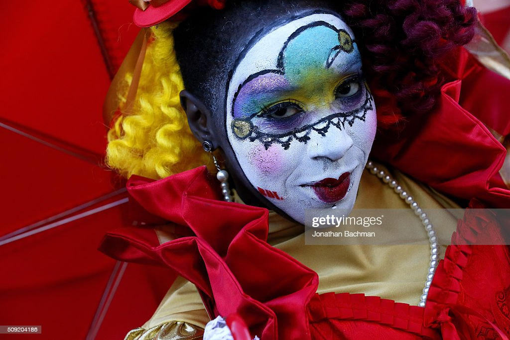A reveler makes her way through the French Quarter during Mardi Gras day on February 9, 2016 in New Orleans, Louisiana. Fat Tuesday, or Mardi Gras in French, is a celebration traditionally held before the observance of Ash Wednesday and the beginning of the Christian Lenten season.