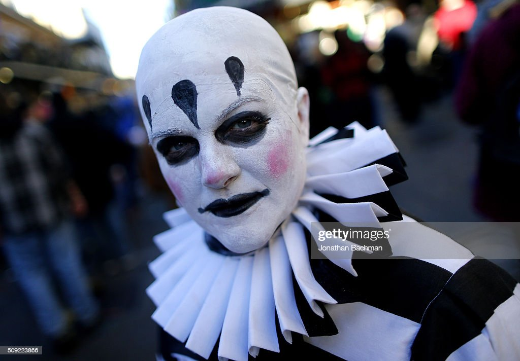 NEW ORLEANS, LOUISIANA - FEBRUARY 9, 2016: A reveler makes her way through the French Quarter during Mardi Gras day on February 9, 2016 in New Orleans, Louisiana. Fat Tuesday, or Mardi Gras in French, is a celebration traditionally held before the observance of Ash Wednesday and the beginning of the Christian Lenten season.