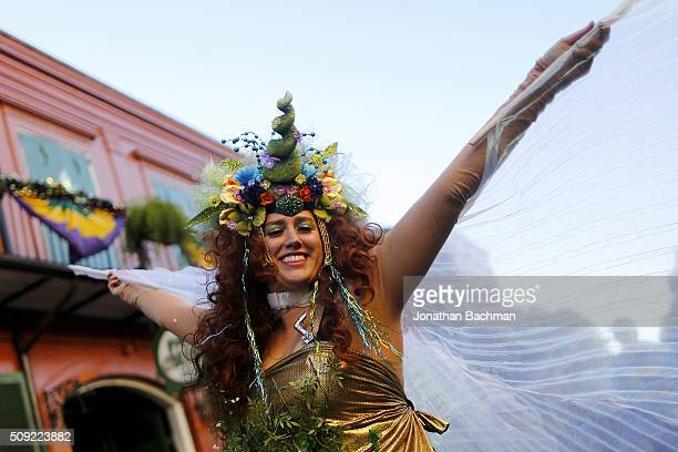 NEW ORLEANS LOUISIANA FEBRUARY 9 2016 A reveler makes her way through the French Quarter during Mardi Gras day on February 9 2016 in New Orleans...