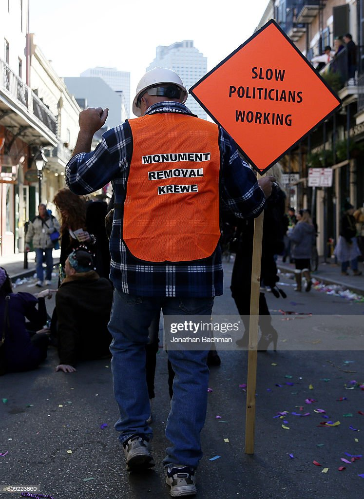 NEW ORLEANS, LOUISIANA - FEBRUARY 9, 2016: A reveler makes his way through the French Quarter during Mardi Gras day on February 9, 2016 in New Orleans, Louisiana. Fat Tuesday, or Mardi Gras in French, is a celebration traditionally held before the observance of Ash Wednesday and the beginning of the Christian Lenten season.