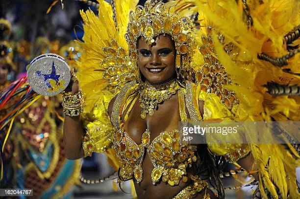 A reveler of BeijaFlor samba school performs during the second night of Carnival parades at the Sambadrome in Rio de Janeiro on February 12 2013 AFP...