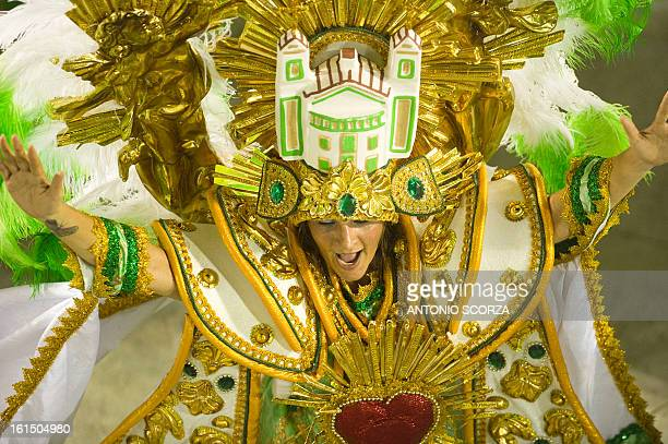 A reveler of Imperatriz Leopoldinense samba school performs during the second night of Carnival parade at the Sambadrome in Rio de Janeiro Brazil on...