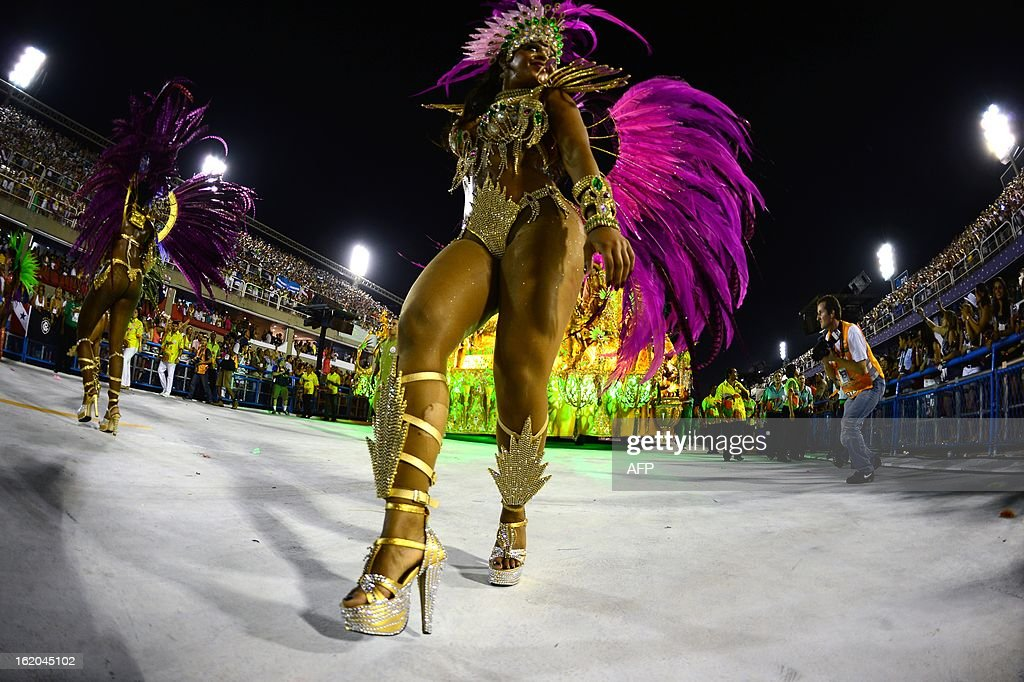A reveler of Mangueira samba school performs during the second night of Carnival parades at the Sambadrome in Rio de Janeiro on February 11, 2013.